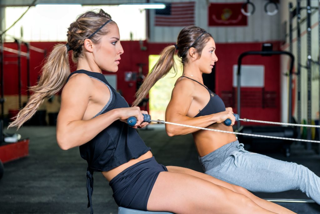 women training on a rowing machine